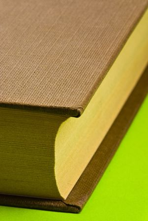 brown book on green background photo