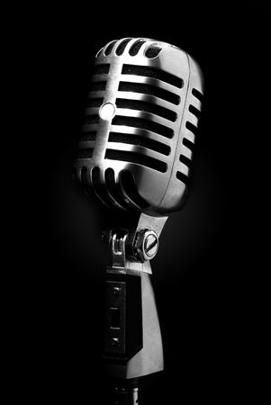 old microphone: vintage microphone on black background