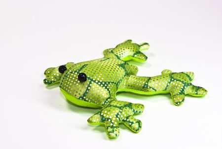 squeaky clean: toy frog on white background