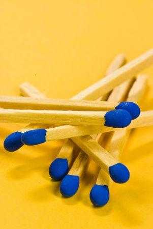 blue matches on yellow background photo