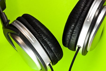 headphones on green background photo