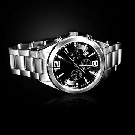 man machine: luxury watch on black background Stock Photo