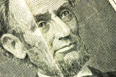 five dollar bill: lincoln face on dollar texture
