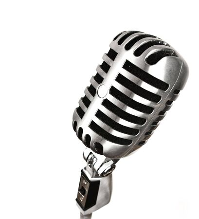 old microphone: metal vintage microhpone on white background