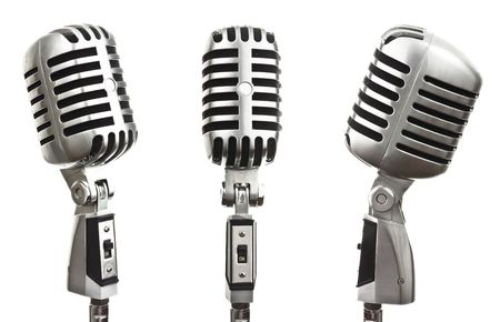 metal vintage microphones on white background