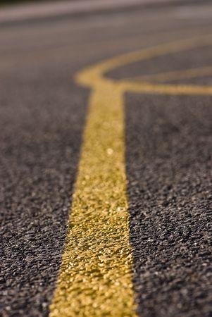 asphalt and yellow line Stock Photo - 5186388