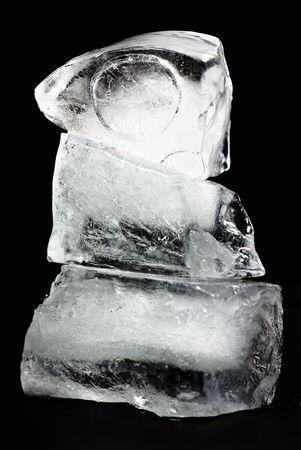 ice cube on black background photo