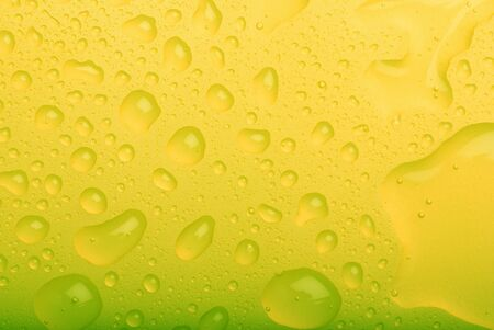 water drops on yellow background photo