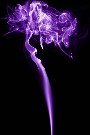 smoke abstract purple on black background photo