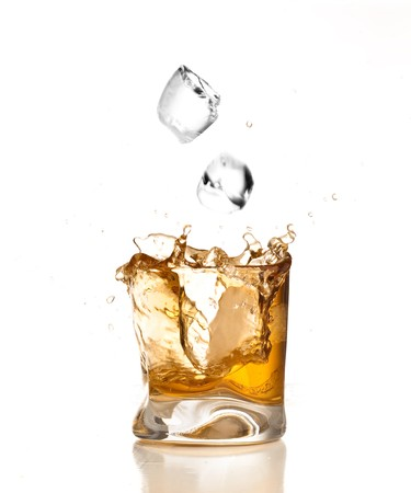 whiskey glass: whiskey splash Stock Photo