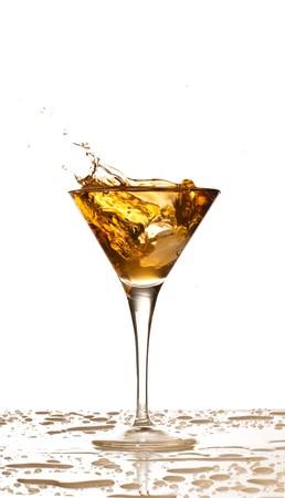 golden cocktail splash Stock Photo - 7787123