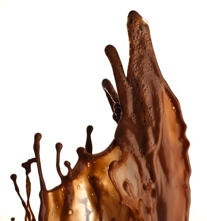 extreme closeup chocolate splash on white background Stock Photo - 7982688