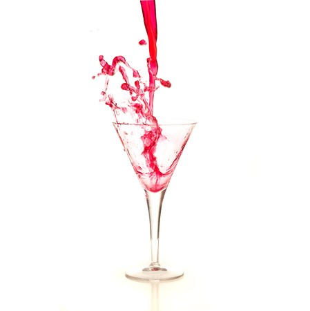 pink and green: cocktail splash isolated on a white background