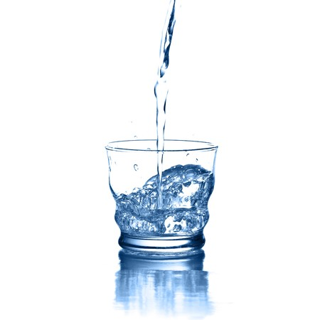 pouring water on glass on a white background Stock Photo - 7982654