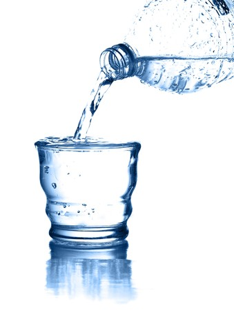 bottle pouring water on glass on white background Stock Photo - 7982673