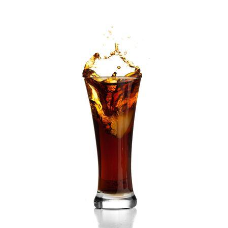 beverage splash into a glass on white background photo