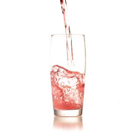 cocktail splashing isolated on a white background Stock Photo - 8158815