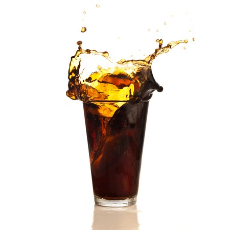 brown beverage splash isolated on white background photo