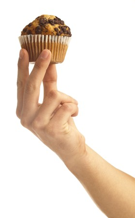 man holding a chocolate muffin on white background Stock Photo - 8193941