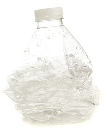 crumpled bottle isolated on a white abckground photo