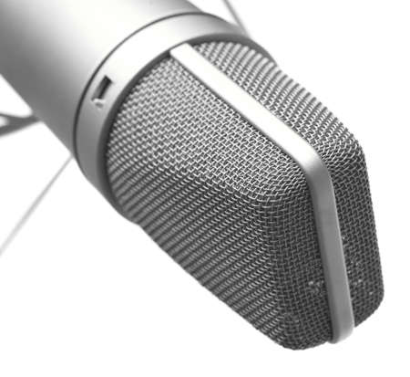 closeup of vintage microphone on white background photo