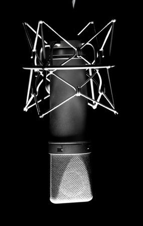 closeup of vintage microphone on a black background photo