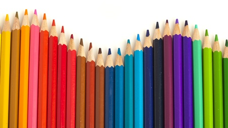 extreme closeup of crayons wave on white background photo