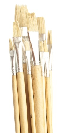 closeup of paintbrushes stack on a white background photo