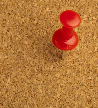 plastic thumbtack on cork billboard extreme closeup Stock Photo - 8229130