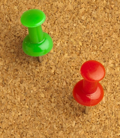 plastic thumbtack on cork billboard extreme closeup Stock Photo - 8229279