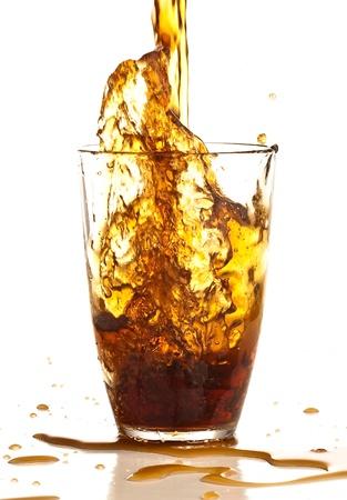 brown beverage splash on a white background photo