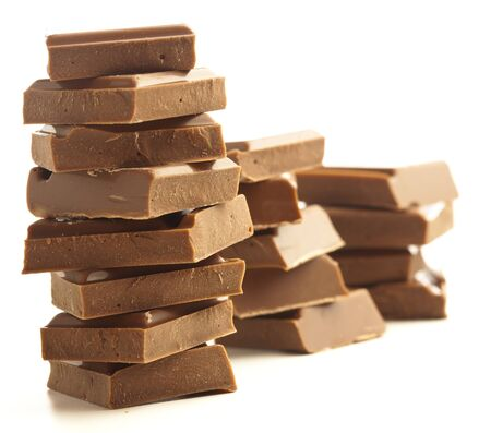 chocolate pieces tower isolated on a white background photo