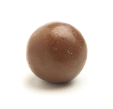 chocolate treats: chocolate ball isolated on a white background