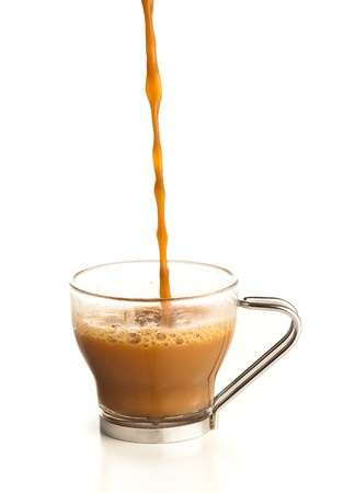 pouring coffee on a cup on a white background photo