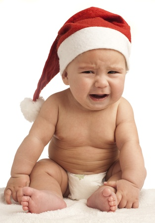 baby with a christmas hat on white background photo