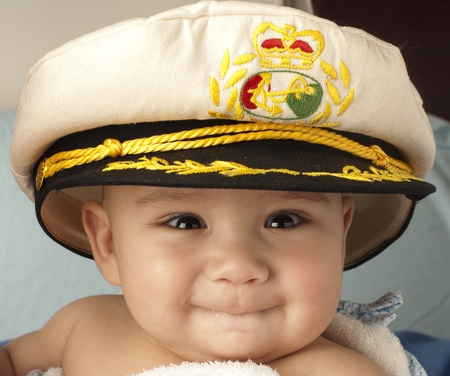 little 4 month baby happy with sailor cap photo