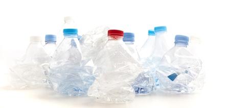 crushed plastic bottles on a white background photo