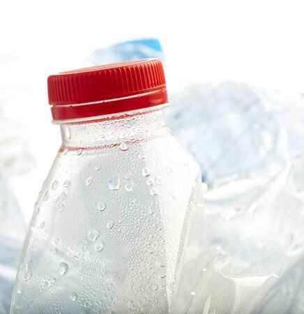 plastic bottles stack to recycle on white background Stock Photo - 8452380