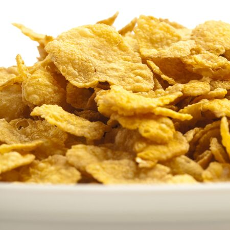 cereal cornflakes pile on a white background photo