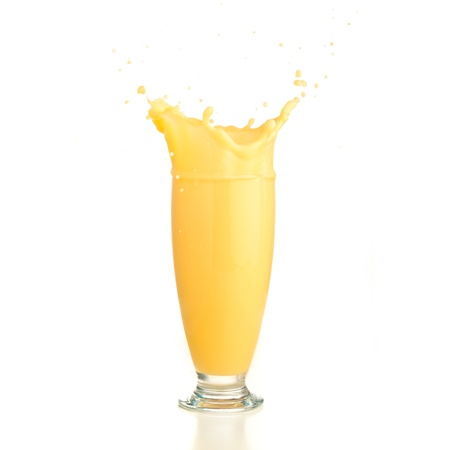 fruit shake: vanilla shake splash on a white background