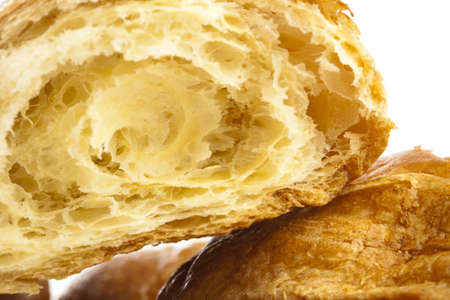 extreme closeup of a delicious croissant on white background photo