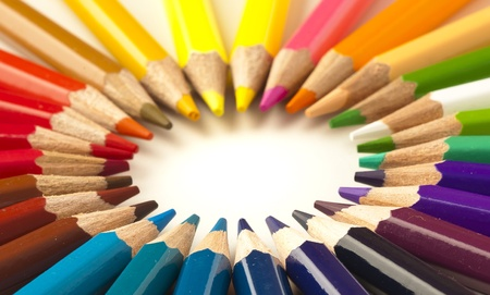 crayons stack circle on a white background photo