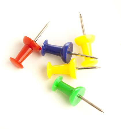 colorful thumbtacks isolated on a white background photo