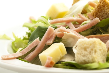 lettuce, cheese, ham and crispy croutons on white photo