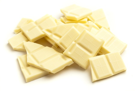chocolate block: white chocolate pieces isolated on a white background