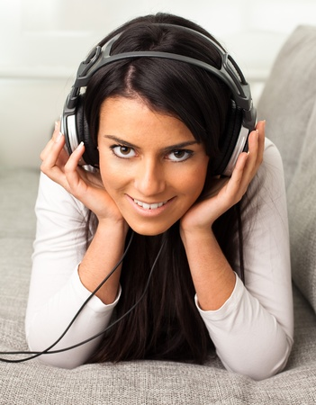 girl listen to music on the sofa photo