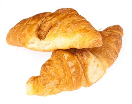 pan frances: recientemente hizo croissant aislado en fondo blanco Foto de archivo