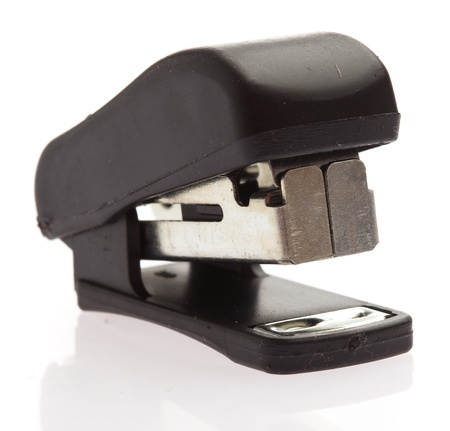 office stapler isolated on a white background photo