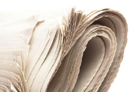 folded newspaper on a white background, closeup photo