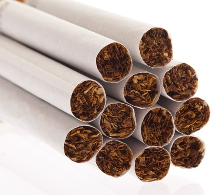 various cigarettes closeup on a white background photo
